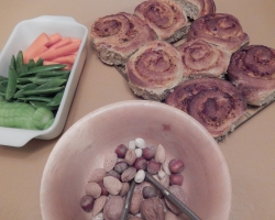 Pizza buns, veggies, and nuts.